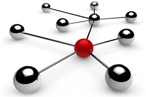Ideas & Business S.r.l. – Sfere d'acciaio unite da tondi d'acciaio creano un'ideale reticolo di realtà interagenti con un soggetto promotore: la sfera rossa